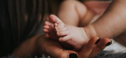 affection baby barefoot blur